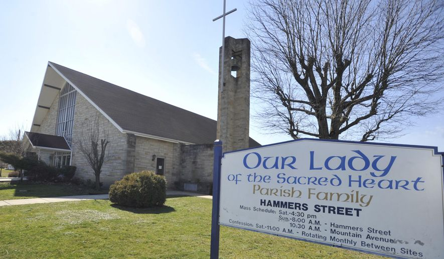 Our Lady of the Sacred Heart Church in Portage, Pa. Thursday, March 9, 2017. Facing a growing number of vacant, neglected structures, Portage Borough Council has taken an unusual approach for encouraging reuse of several former church properties. Council voted  to explore revoking tax-exempt status for the former Our Lady of the Sacred Heart Parish church buildings and a former church school. (Todd Berkey /The Tribune-Democrat via AP)