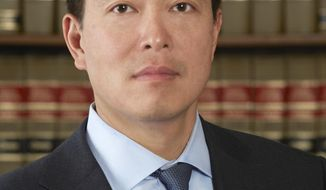 In this undated photo provided by the U.S. Attorney's Office, Joon Kim poses for a photo. Kim, 45, will be acting U.S. attorney in the Southern District of New York until President Trump nominates a candidate for the job who can be confirmed by the Senate. (U.S. Attorney's Office via AP)