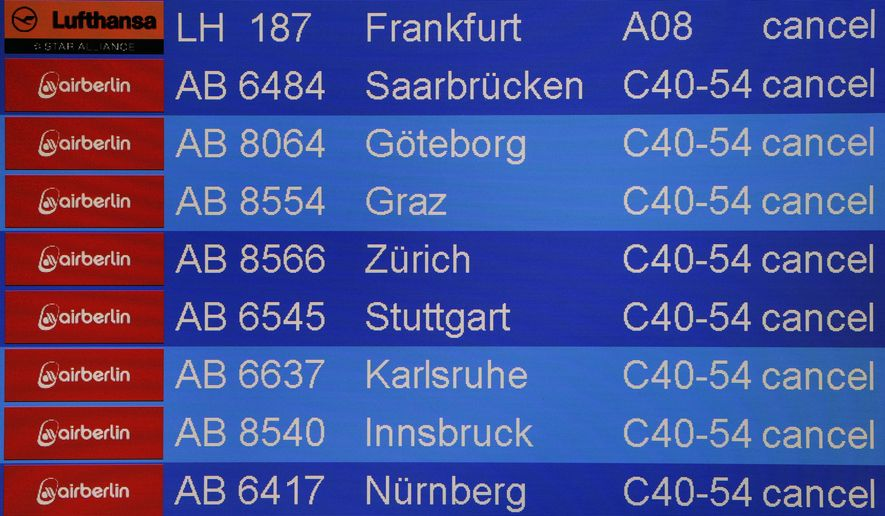 Cancelled flights appear on a flight information board when German ver.di union went on a strike at the airport Tegel in Berlin, Germany, Monday, March 13, 2017. The union, representing airport ground staff, has called on its members to go on strike again at Berlin's two airports Tegel and Schoenefeld. (AP Photo/Michael Sohn)