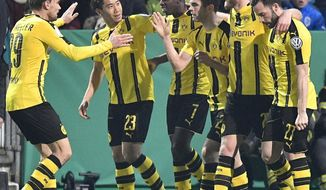 Dortmund's Christian Pulisic, 3rd from right, is celebrated after scoring the opening goal during the German Soccer Cup quarterfinal match between SF Lotte and Borussia Dortmund in Osnabrueck, Germany, Tuesday, March 14, 2017. (AP Photo/Martin Meissner)