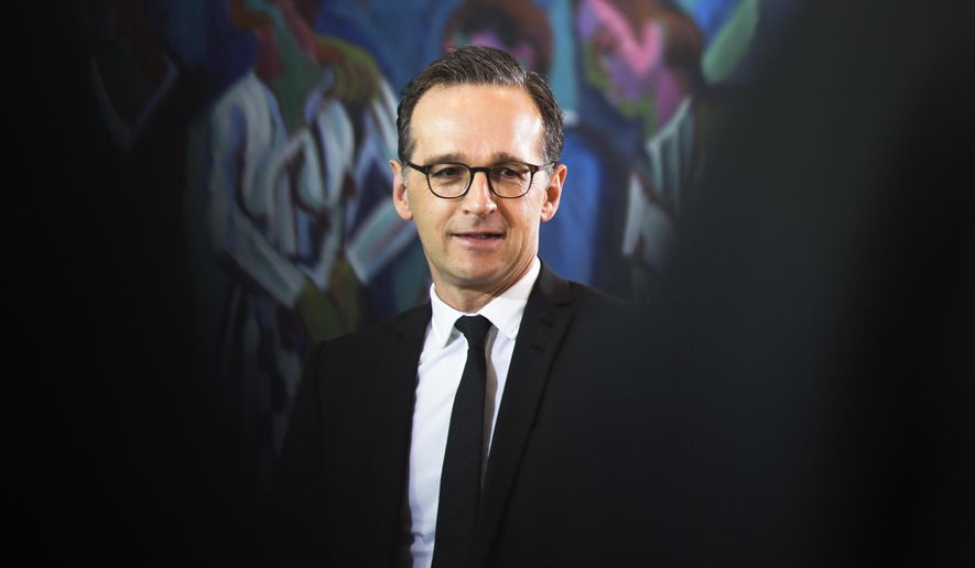 """In this March 8, 2017, file photo, German Justice Minister Heiko Maas arrives for the weekly cabinet meeting of the German government at the chancellery in Berlin. Germany's justice minister is proposing fines of up to 50 million euros ($53 million) for social networking sites that fail to swiftly remove illegal content, such as hate speech or defamatory """"fake news."""" (AP Photo/Markus Schreiber/dpa via AP)"""