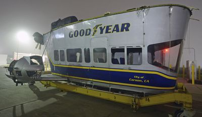 """This photo provided by The Goodyear Tire & Rubber Company shows the gondola from the Goodyear Blimp """"Sprit of Innovation"""" after the blimp was deflated early Tuesday, March 14, 2017. Goodyear has let the helium out of the last of its fabled fleet of blimps, but the company's flight program will continue. (Jessica Yanesh/The Goodyear Tire & Rubber Company via AP)"""