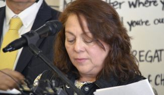 Honduran immigrant Emma Membreno Sorto reads a statement on Tuesday, March 14, 2017 about seeking refuge at a Quaker church in Albuquerque to avoid potential deportation by federal immigration authorities. The Friends Meeting House announced Tuesday volunteers will help give Membreno Sorto around-the-clock protection from federal immigration authorities while she stays in church facilities. The Quaker church in Albuquerque says it is joining churches across the country giving sanctuary shelter to immigrants facing deportation. (AP Photo/Russell Contreras)