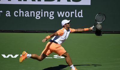 Fernando Verdasco, of Spain, returns a shot to Rafael Nadal, of Spain, at the BNP Paribas Open tennis tournament, Tuesday, March 14, 2017, in Indian Wells, Calif. (AP Photo/Mark J. Terrill)