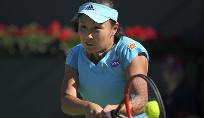 Peng Shuai, of China, returns a shot to Venus Williams at the BNP Paribas Open tennis tournament, Tuesday, March 14, 2017, in Indian Wells, Calif. (AP Photo/Mark J. Terrill)