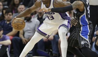 Orlando Magic guard C.J. Watson, guards Sacramento Kings forward Anthony Tolliver, left, during the first half of an NBA basketball game, Monday, March 13, 2017, in Sacramento, Calif. (AP Photo/Rich Pedroncelli)