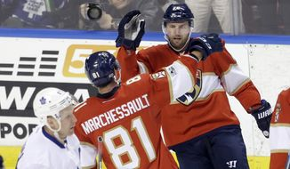 Florida Panthers center Jonathan Marchessault (81) is congratulated by teammate Thomas Vanek (26) after Marchessault scored against the Toronto Maple Leafs in the first period of an NHL hockey game, Tuesday, March 14, 2017, in Sunrise, Fla. (AP Photo/Alan Diaz)
