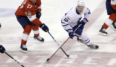 Florida Panthers center Nick Bjugstad (27) battles Toronto Maple Leafs right wing Connor Brown (12) for the puck in the first period of an NHL hockey game, Tuesday, March 14, 2017, in Sunrise, Fla. (AP Photo/Alan Diaz)