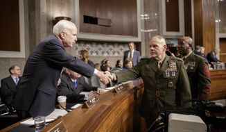 "Senate Armed Services Committee Chairman Sen. John McCain, R-Ariz., left, welcomes Marine Corps Commandant Gen. Robert B. Neller, center, and Sgt. Major of the Marine Corps Ronald L. Green on Capitol Hill in Washington, Tuesday, March, 14, 2017, prior to the start of the committee's hearing on the investigation of nude photographs of female Marines and other women that were shared on the Facebook page ""Marines United.""  (AP Photo/J. Scott Applewhite)"
