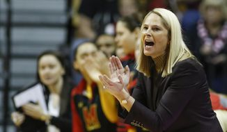 FILE - In this Sunday, Feb. 5, 2017, file photo ,Maryland head coach Brenda Frese cheers on her team during the first half of an NCAA college basketball game against Indiana in Bloomington, Ind. Ranked fourth in the country after going 30-2 and being crowned Big Ten champions for a third consecutive year, Maryland was stunned and disappointed to receive a No. 3 seed in the NCAA Tournament. (AP Photo/Sam Riche, File)