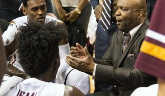 FILE - In this Jan. 21, 2017, file photo, Florida State head coach Leonard Hamilton, right, talks to his team during a timeout in the first half of an NCAA college basketball game against Louisville in Tallahassee, Fla. Hamilton seems to have Florida State finally heading in the right direction again. The Seminoles are back in the NCAA Tournament after a five-year absence. (AP Photo/Mark Wallheiser, File)