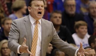 FILE- In this Jan. 14, 2017, file photo, Oklahoma State head coach Brad Underwood argues a call during the first half of an NCAA college basketball game against Kansas, Saturday, Jan. 14, 2017, in Lawrence, Kan. Underwood has the Cowboys back in the NCAA Tournament. The Cowboys face Michigan on Friday in Indianapolis. (AP Photo/Charlie Riedel, File)
