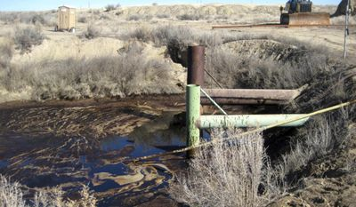 This photo supplied by the Environmental Protection Agency shows oil trapped by a berm and siphon dam in a dry ravine where the oil from a Chevron spill was stopped March 7, 2017, near Rangely, Colo. Chevron Corp. says its crews are cleaning up about 4,800 gallons of oil that spilled from a failed pipeline into an intermittent stream on public land in northwestern Colorado. State officials said Tuesday, March 14, 2017, that the oil travelled about 2 miles downstream along an unnamed tributary of Stinking Water Creek in Rio Blanco County. (Environmental Protection Agency via AP)