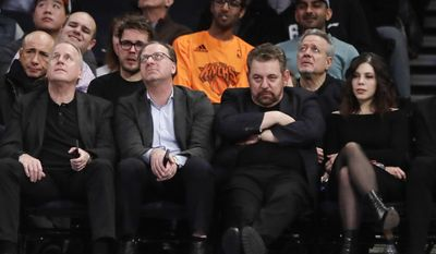 Madison Square Garden chairman James Dolan, second from right, watches during the first half of an NBA basketball game between the New York Knicks and the Indiana Pacers Tuesday, March 14, 2017, in New York. (AP Photo/Frank Franklin II)