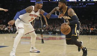 New York Knicks' Carmelo Anthony (7) defends Indiana Pacers' Paul George (13) during the first half of an NBA basketball game Tuesday, March 14, 2017, in New York. (AP Photo/Frank Franklin II)