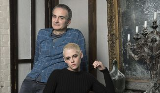 """Kristen Stewart, right, and writer-director Olivier Assayas pose for a portrait to promote their film, """"Personal Shopper"""" on Thursday, March 9, 2017, in New York. (Photo by Amy Sussman/Invision/AP)"""