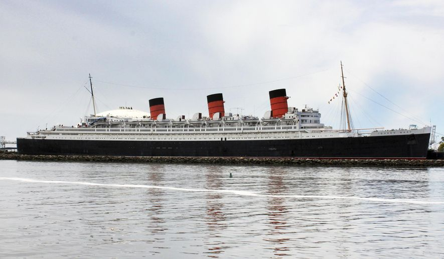 """This May 15, 2015 photo shows the retired Cunard ocean liner Queen Mary, at its permanent mooring in the harbor at Long Beach, Calif. A survey has found the ship is so corroded that it's at urgent risk of flooding, and the price tag for fixing up the 1930s ocean liner could near $300 million. Documents obtained the Long Beach Press-Telegram show it would take five years to rehab the ship. Engineers who compiled the survey warn that the vessel is probably """"approaching the point of no return."""" (AP Photo/John Antczak)"""
