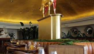In this Tuesday, Feb. 14, 2017 photo, a unicorn sculpture by artist Damien Hirst is displayed in the Pao by Paul Qui restaurant in the Faena Hotel in Miami Beach, Fla. The beachfront hotel is the flagship of Faena District, a cluster of buildings developed by Argentine hotel magnate Alan Faena where decaying structures and empty parking lots are giving way to opulent hotels, condos, and a performing arts center. (AP Photo/Lynne Sladky)