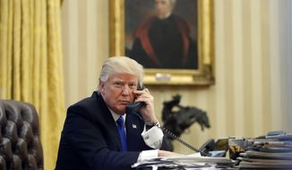 In this Saturday, Jan. 28, 2017 photo, President Donald Trump speaks on the telephone with Australian Prime Minister Malcolm Turnbull in the Oval Office of the White House in Washington. (AP Photo/Alex Brandon, File)
