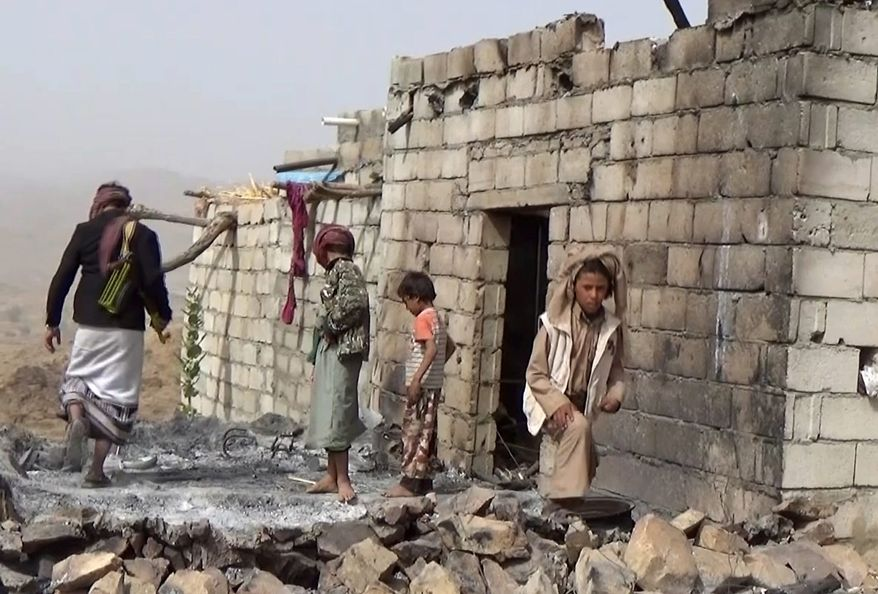 Houses in a tiny Yemeni village were damaged in a January 29 U.S. raid that left at least 25 Yemenis and a U.S. Navy SEAL dead, showing how difficult it is to tell who is al Qaeda in a country where the militants are mingled with tribes and are fighting on the same side as the government against the rebels. (Associated Press)