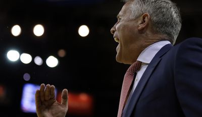 Philadelphia 76ers coach Brett Brown yells to players during the first half of an NBA basketball game against the Golden State Warriors on Tuesday, March 14, 2017, in Oakland, Calif. (AP Photo/Ben Margot)