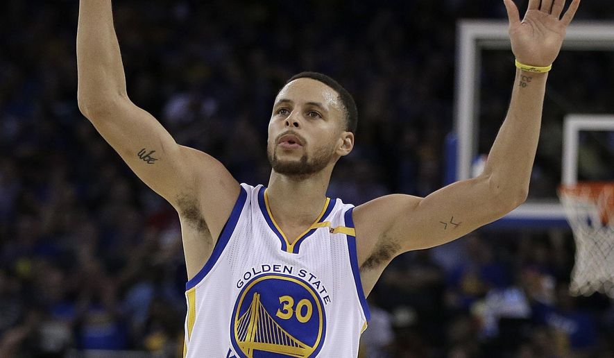 Golden State Warriors' Stephen Curry celebrates a score against the Philadelphia 76ers during the second half of an NBA basketball game Tuesday, March 14, 2017, in Oakland, Calif. Warriors won, 106-104. (AP Photo/Ben Margot)