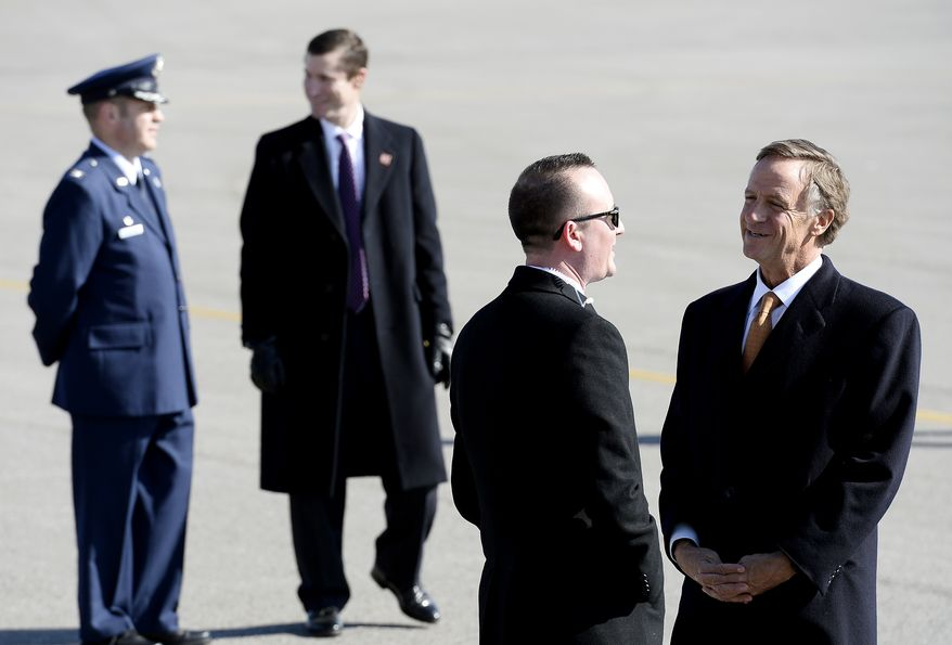 Tennessee Gov. Bill Haslam, right, waits for Air Force One with President Donald Trump aboard, to arrive Wednesday, March 15, 2017, in Nashville, Tenn. Trump is scheduled to visit the home of President Andrew Jackson and later in the day speak about health care at a rally. (AP Photo/Mark Zaleski)