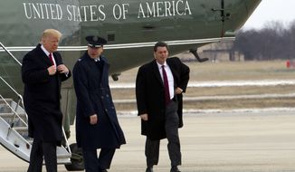 President Donald Trump, escorted by Commander of the 89th Airlift Wing Col. Casey D. Eaton, walks from Marine One to board Air Force One upon his arrival at Andrews Air Force Base, Md., Wednesday, March 15, 2017, en route to Michigan and Tennessee and returning to Washington later this evening. ( AP Photo/Jose Luis Magana)