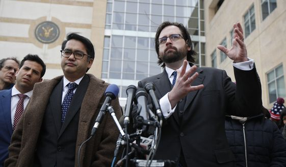 Justin Cox of the National Immigration Law Center, representing all the plaintiffs, right, with Omar Jadwat of ACLU, speaks to reporters outside the courthouse in Greenbelt, Md., Wednesday, March 15, 2017. A federal judge in Maryland says he will issue a ruling in a lawsuit challenging President Donald Trump's revised travel ban. (AP Photo/Manuel Balce Ceneta)