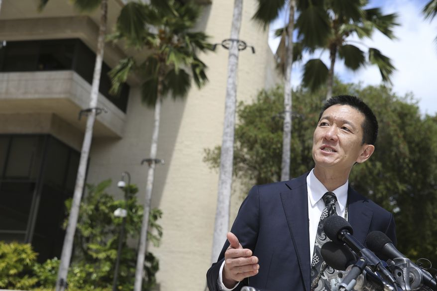 Hawaii Attorney General Douglas Chin speaks at a press conference outside the federal courthouse, Wednesday, March 15, 2017, in Honolulu. Hearings were scheduled Wednesday in Maryland, Washington state and Hawaii on President Donald Trump's travel ban. Hawaii's lawsuit claims the ban harms Hawaii by highlighting the state's dependence on international travelers, its ethnic diversity and its welcoming reputation as the Aloha State. (AP Photo/Marco Garcia)