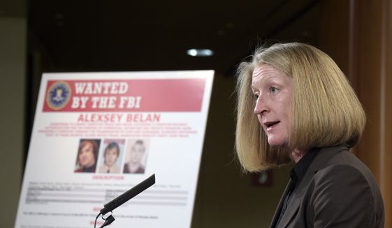 Acting Assistant Attorney General Mary McCord speaks during a news conference at the Justice Department in Washington, Wednesday, March 15, 2017. The Justice Department announced charges against four defendants, including two officers of Russian security services, for a mega data breach at Yahoo. (AP Photo/Susan Walsh)