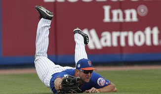 New York Mets left fielder Tim Tebow makes a diving catch on a fly ball by Miami Marlins' Justin Bour in the second inning of a spring training baseball game Monday, March 13, 2017, in Port St. Lucie, Fla. (AP Photo/John Bazemore)
