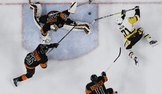 Pittsburgh Penguins' Evgeni Malkin (71) cannot get a shot past Philadelphia Flyers' Steve Mason (35) as Travis Konecny (11) and Nick Schultz (55) defend during the first period of an NHL hockey game, Wednesday, March 15, 2017, in Philadelphia. (AP Photo/Matt Slocum)