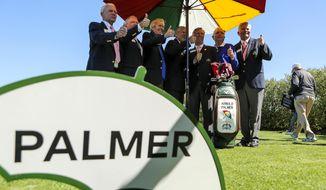 Arnold Palmer Invitational officials pose for a photo with Arnold Palmer's golf bag on Wednesday morning, March 15, 2017,  at the Arnold Palmer Invitational golf tournament in Orlando, Fla.  (Jacob Langston/Orlando Sentinel via AP)