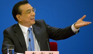Chinese Premier Li Keqiang speaks at a press conference after the closing session of the National People's Congress held in the Great Hall of the People in Beijing, China, Wednesday, March 15, 2017. (AP Photo/Ng Han Guan)