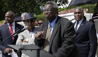 File-In this Thursday, June 27, 2013 file photo, Sen. Hank Sanders, center, and other black leaders gather on the steps of the Alabama Capitol in Montgomery, Ala. Sanders is one lawmaker and he's waging a nearly two-decade battle to repeal Alabama's death penalty. He has unsuccessfully introduced bills year after year to end capital punishment in his Southern state.(AP Photo/Dave Martin, File)