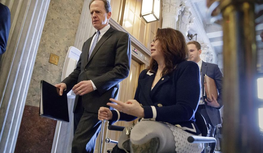Sen. Pat Toomey, R-Pa., left, and Sen. Tammy Duckworth, D-Ill., arrive at the Senate chamber on Capitol Hill in Washington, Wednesday, March, 15, 2017, for a vote to confirm former Indiana Sen. Dan Coats as director of national intelligence. (AP Photo/J. Scott Applewhite) ** FILE **