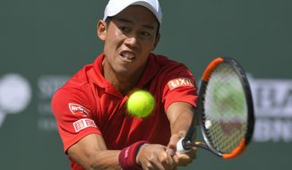 Kei Nishikori, of Japan, returns a shot against Donald Young at the BNP Paribas Open tennis tournament, Wednesday, March 15, 2017, in Indian Wells, Calif. Nishikori won 6-2, 6-4. (AP Photo/Mark J. Terrill)