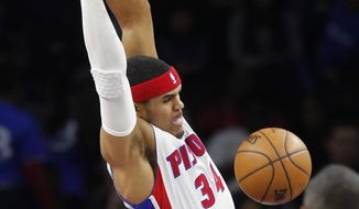 Detroit Pistons forward Tobias Harris dunks during the first half of the team's NBA basketball game against the Utah Jazz, Wednesday, March 15, 2017, in Auburn Hills, Mich. (AP Photo/Carlos Osorio)