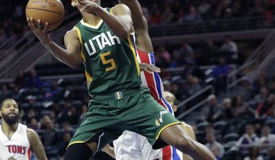 Utah Jazz guard Rodney Hood (5) shoots during the first half of the team's NBA basketball game against the Detroit Pistons, Wednesday, March 15, 2017, in Auburn Hills, Mich. (AP Photo/Carlos Osorio)