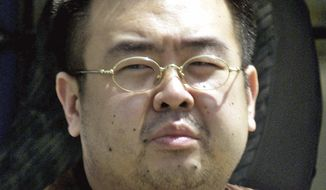 This May 4, 2001, file photo shows Kim Jong-nam, exiled half brother of North Korea's leader Kim Jong-un, in Narita, Japan. Kim Jong-nam, 46, was targeted Monday, Feb. 13, 2017, in the Kuala Lumpur International Airport, Malaysia, and later died on the way to the hospital according to a Malaysian government official. (AP Photos/Shizuo Kambayashi, File)