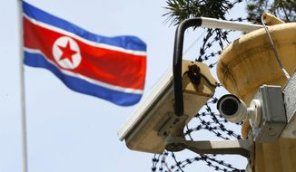 A CCTV surveillance camera is attached by the entrance gate at the North Korean Embassy in Kuala Lumpur, Malaysia, Monday, March 13, 2017. Malaysia's health minister said Monday that the government will give relatives of North Korean leader Kim Jong Un's estranged half brother two to three weeks to claim his body before deciding what to do with it. (AP Photo/Vincent Thian)