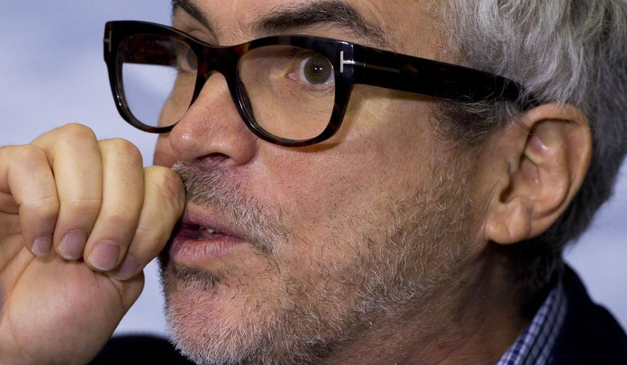 """Mexican director Alfonso Cuaron answers questions during a press conference following the end of filming of his new movie """"Roma,"""" in Mexico City, Tuesday, March 14, 2017. """"Roma,"""" a family drama set in the 1970s, marks the first time the Oscar-winning director has filmed in his home country since 2001's """"Y tu mama tambien."""" (AP Photo/Rebecca Blackwell)"""