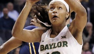 FILE - In this Monday, March 6, 2017, file photo, Baylor forward Nina Davis (13) shoots in the first half of an NCAA college basketball game against  West Virginia at the Big 12 Conference tournament championship in Oklahoma City. Davis is a two-time AP All-American who has been to the Elite Eight three times while setting plenty of Baylor and Big 12 records. But her standout career will feel incomplete without a Final Four trip or national title. This is the senior's last chance. (AP Photo/Sue Ogrocki, File)