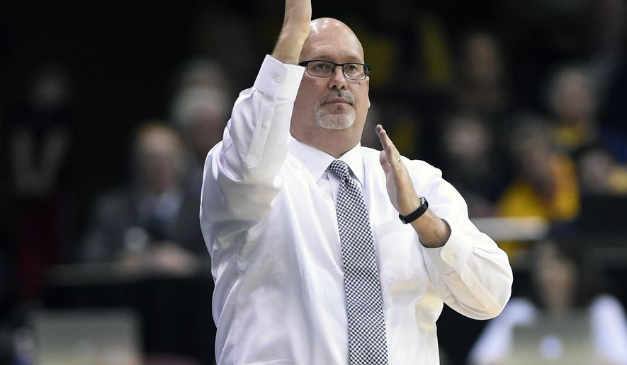FILE - In this March 6, 2017, file photo, East Tennessee State's head coach Steve Forbes directs his team during an NCAA college basketball game for the Southern Conference tournament championship in Asheville, N.C. Forbes' background makes him an ideal fit for a team that features plenty of junior-college transfers. March 6, 2017, file photoForbes identifies with those guys because he also has a junior-college background. (AP Photo/Kathy Kmonicek, File)