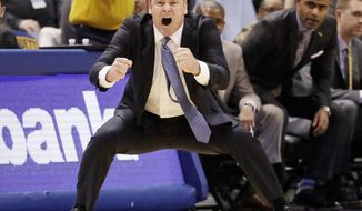 FILE - In this Dec. 28, 2016, file photo, Marquette head coach Steve Wojciechowski reacts during the second half of an NCAA college basketball game against Georgetown in Milwaukee. In this, the 100th anniversary of Marquette basketball and 40th anniversary of the Al McGuire-coached team winning the national title, current coach Steve Wojciechowski is marking his own important milestone. The Golden Eagles are back in the NCAA tournament after a four-year absence. (AP Photo/Morry Gash, File)