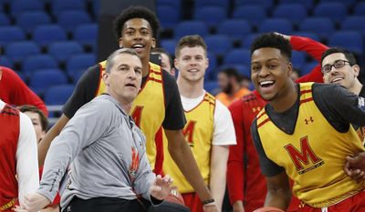Maryland head coach Mark Turgeon, center, reacts as he attempts a half-court shot during practice at the NCAA college basketball tournament, Wednesday, March 15, 2017 in Orlando, Fla. (AP Photo/Wilfredo Lee) **FILE**