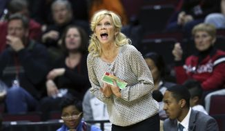 In this Thursday, Feb. 18, 2016, photo, Michigan State coach Suzy Merchant reacts as she is called for a technical foul during the first half of an NCAA college basketball game against Rutgers in Piscataway, N.J. Merchant is trying to enjoy this year's trip to the NCAA Tournament after surviving some heart-related health scares this season. The ninth-seeded Spartans will face eighth-seeded Arizona State on Friday, March 17, 2017, in South Carolina. (AP Photo/Mel Evans)