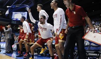 The Southern California bench reacts during the second half of the team's First Four game against Providence in the NCAA men's college basketball tournament, Wednesday, March 15, 2017, in Dayton, Ohio. Southern California won 75-71. (AP Photo/John Minchillo)