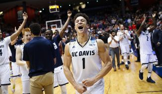 UC Davis' Lawrence White (1) celebrates after a First Four game of the NCAA men's college basketball tournament, Wednesday, March 15, 2017, in Dayton, Ohio. UC Davis defeated North Carolina Central 67-63. (AP Photo/John Minchillo)